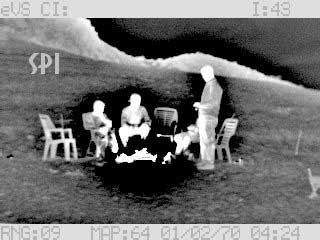 A thermal image of people taken at night