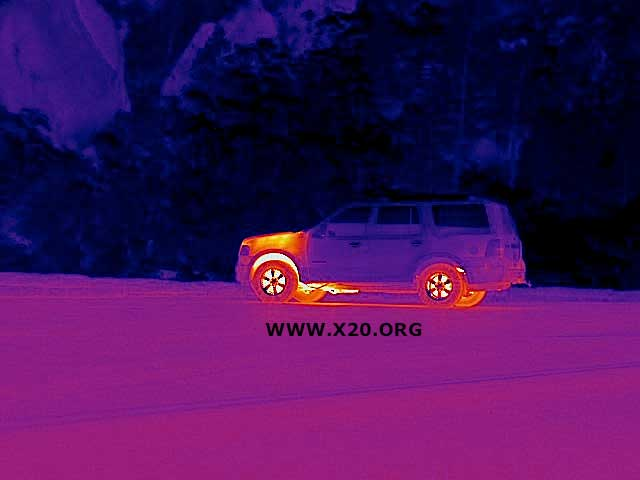 FLIR EOIR gimbal thermal image of an SUV