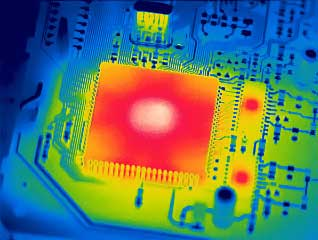 Thermal scan of a circuit board chip in rainbow thermal color.