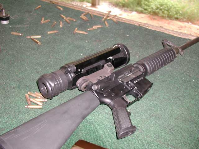 The Specre IR thermal scope mounted on a hog hunting rifle