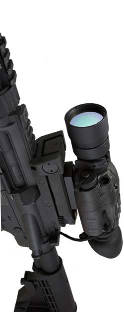 HTMI Mini thermal scope mounted on a rifle, vertically