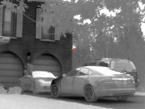 An image of a car through a thermal rifle scope