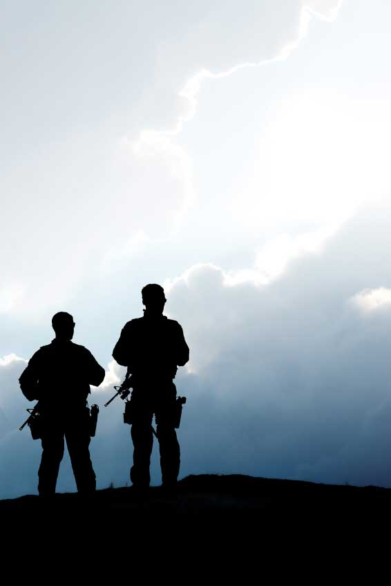 A silhouette of two soldiers with thermal rifle scopes