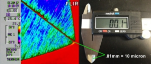 In the above image you can get a sense of the spatial resolution of the Thermal Microscope. This is an image of a standard caliper using the thermal microscope. You can see that .01mm=10 microns. The image shows the jaws of the caliper when set to .01mm. You cannot see the space with your bare eyes. Under the thermal microscope you can clearly see the space between the jaws.