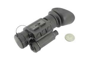HTMI FLIR mini thermal monocular next to a quarter