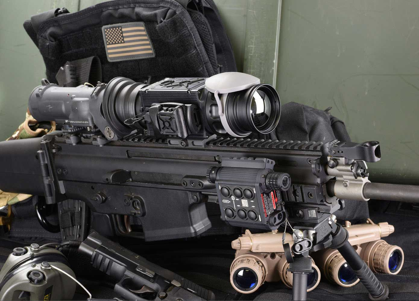 X39 Clip On FLIR Thermal Imaging Rifle Sight mounted on a rifle. Shown with Night vision goggles and TMSLS laser rail system (not included).