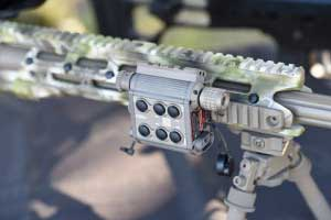 TMSLS tactical laser illuminator mounted on a rifle