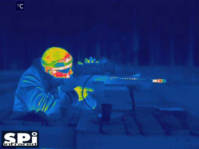 Color FLIR infrared image of a soldier at a shooting range, using a thermal scope from SPI