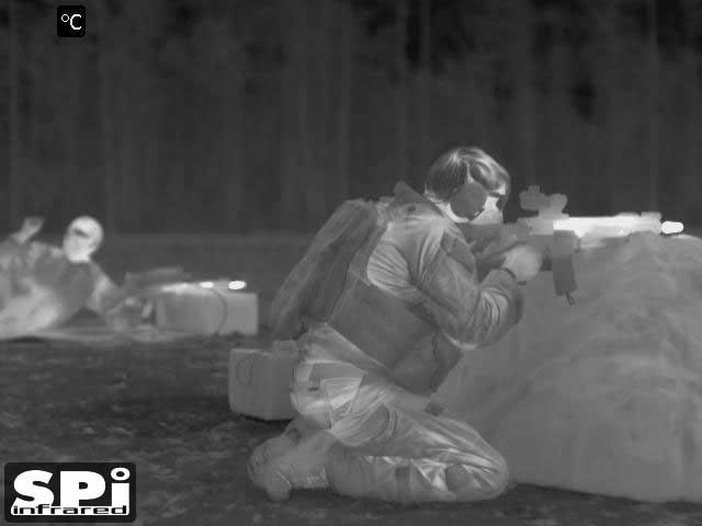FLIR infrared image of a soldier at a shooting range with a thermal scope on his rifle