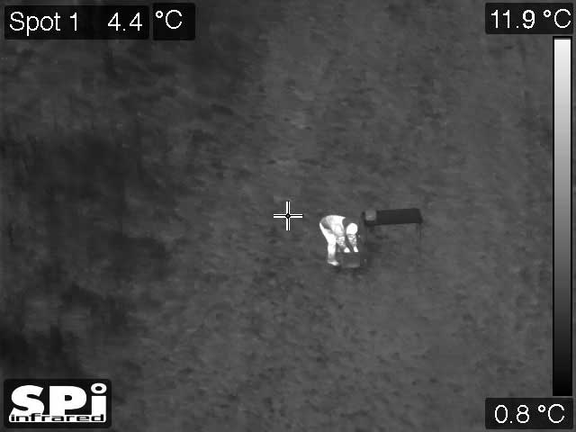 Ir Surveillance Image Of A Possible Ied Being Placed In A Road