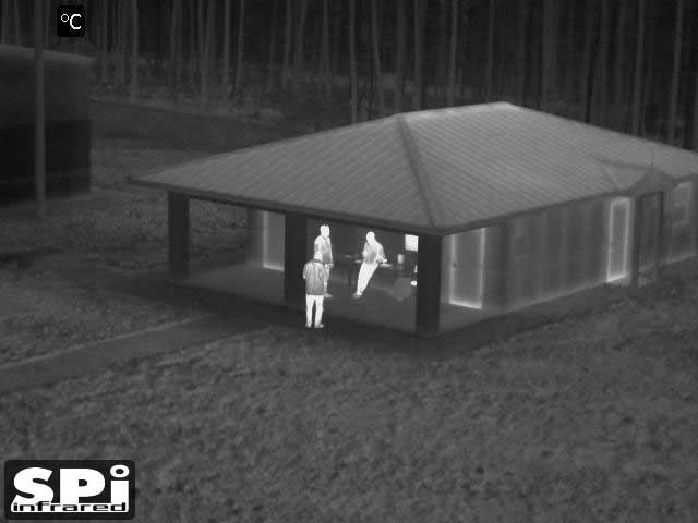FLIR clip on image of a a group of people by a building